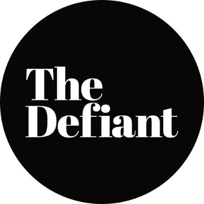 "round black circle with the words ""the defiant"" in white"