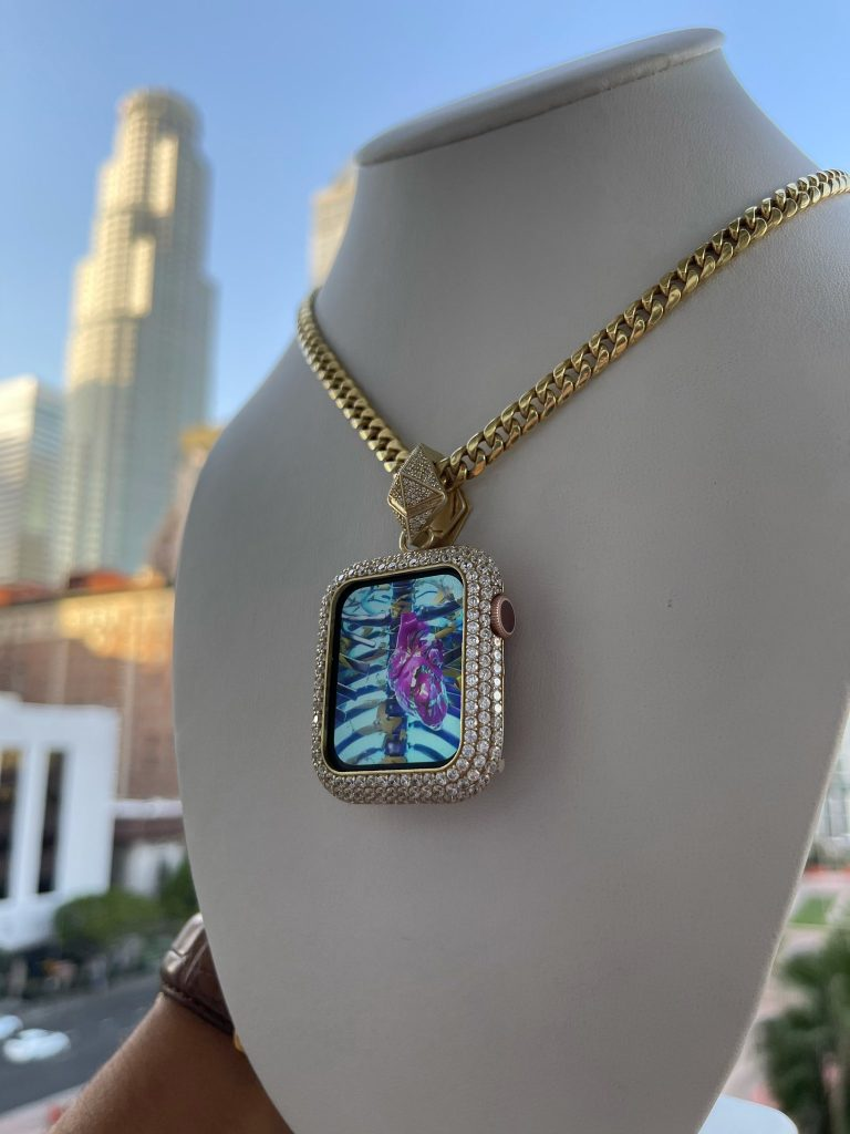 diamond studded pendant featuring art image on gold chain