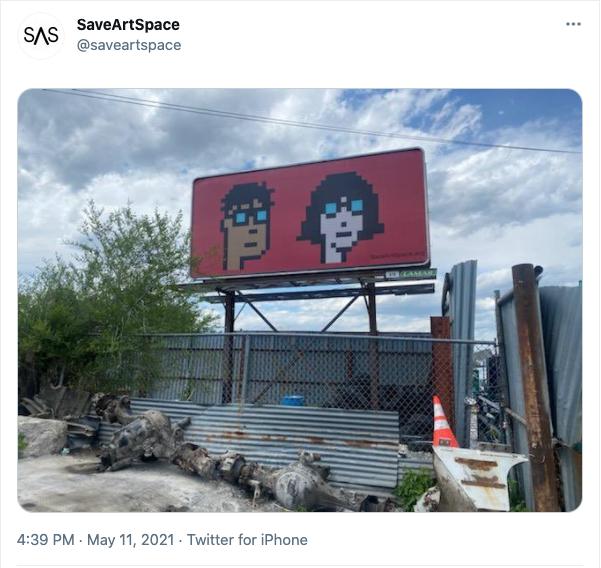 billboard featuring two cryptopunks