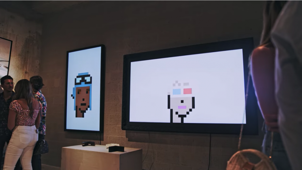 gallery with digital displays featuring cryptopunks